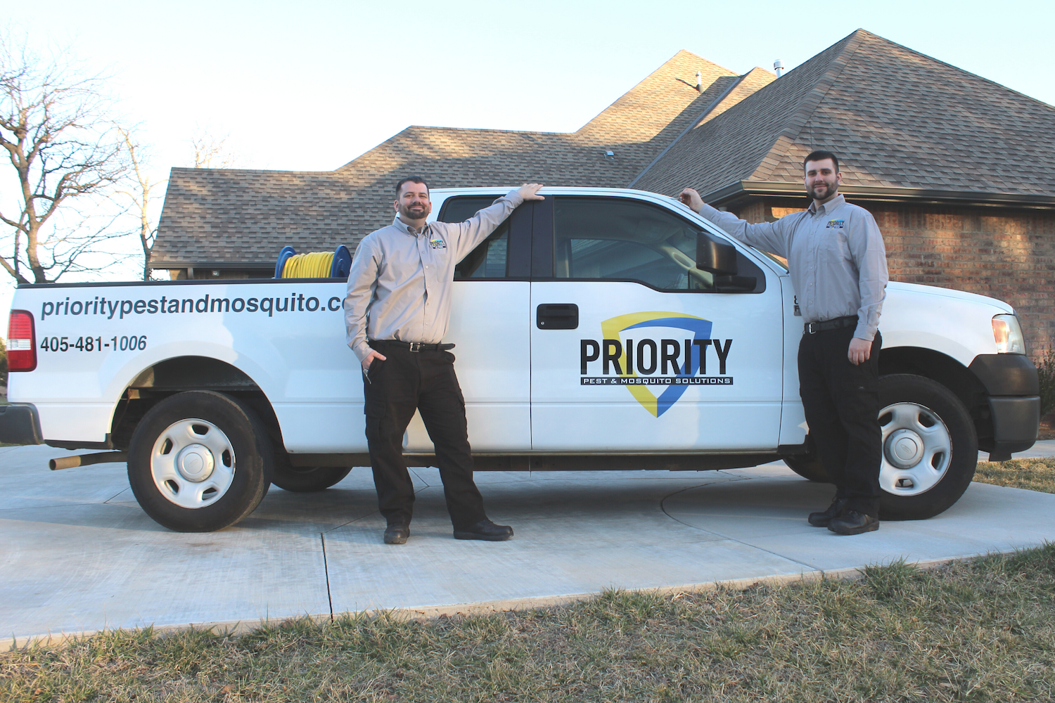 Chantz and Justin in front of their Priority Pest Truck